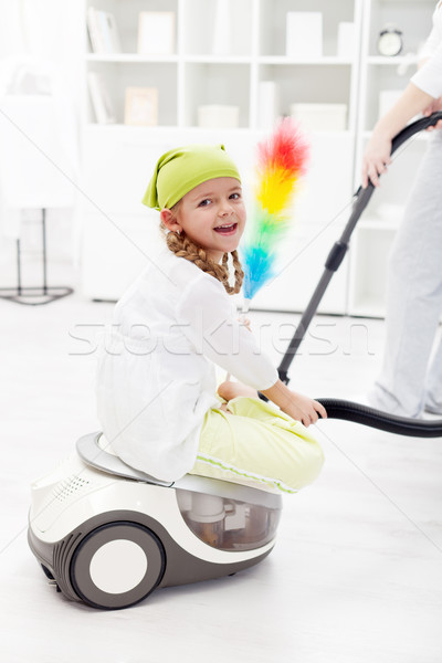 Stock photo: Little girl helping mother to clean the room