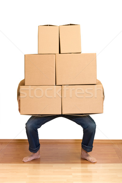 Man struggling while lifting lots of cardboard boxes Stock photo © ilona75