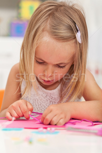 Little girl working on a crafting project Stock photo © ilona75