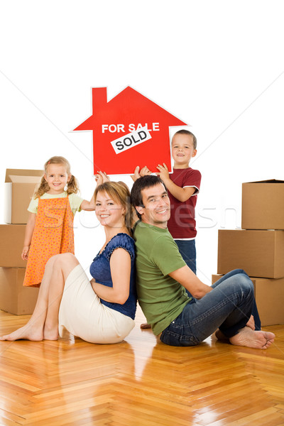 Happy family in their new home Stock photo © ilona75