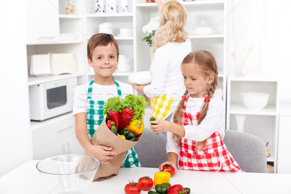 Kids unpacking groceries in the kitchen Stock photo © ilona75