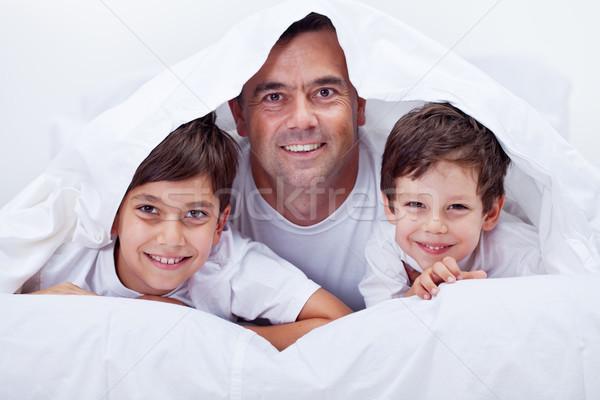 Père paresseux temps ensemble famille Photo stock © ilona75