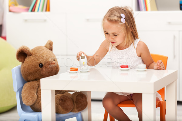 Little girl playing with her toy bear - having a tea party Stock photo © ilona75