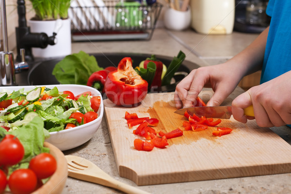 Kid hands chopping red bellpepper for a delicious vegetable sala Stock photo © ilona75