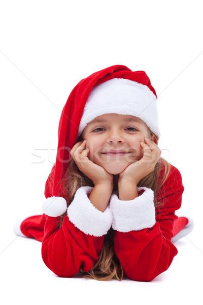 Happy christmas girl propping her head Stock photo © ilona75