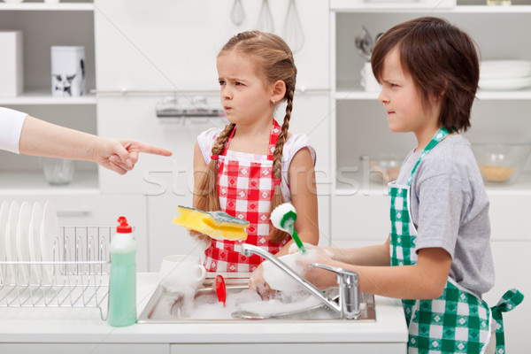 Kids ordered to do the dishes Stock photo © ilona75