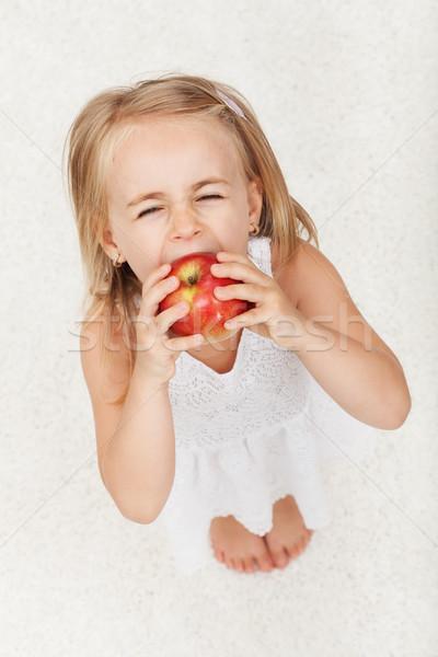 Jovem grande morder maçã Foto stock © ilona75