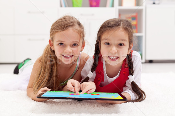 Little girls using tablet computer as artboard Stock photo © ilona75