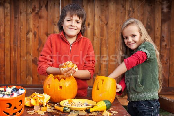 Kids carving their pumpkin jack-o-lanterns Stock photo © ilona75