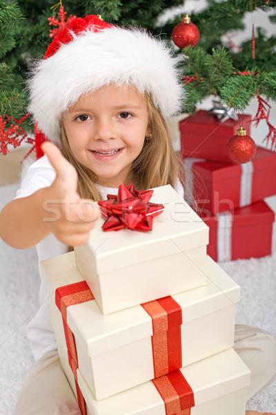 Happy little girl with lots of christmas presents Stock photo © ilona75