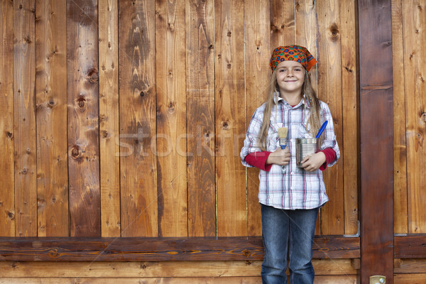 Happy little girl proud to repaint the wood shed Stock photo © ilona75