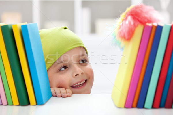Cleaning day - boy dusting books Stock photo © ilona75