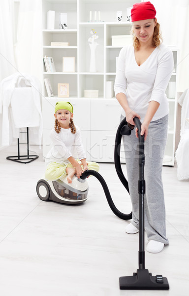 Cleaning day - woman and little girl tidy the room Stock photo © ilona75