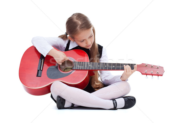 Little girl with red guitar, sitting Stock photo © ilona75