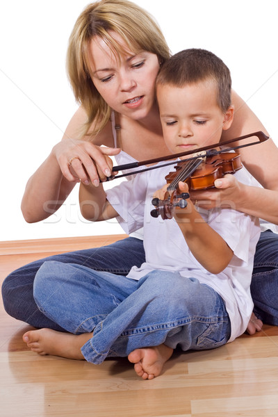 Little boy practicing the violin Stock photo © ilona75