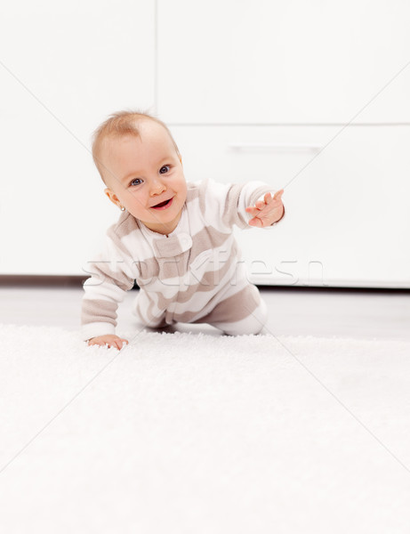 Baby girl learns to crawl Stock photo © ilona75