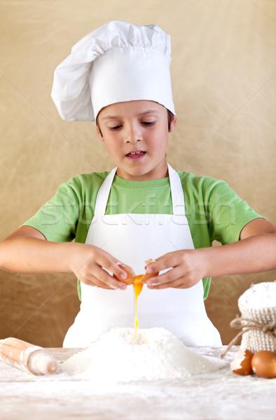 Fiú szakács sapka tojások liszt köteg étel Stock fotó © ilona75
