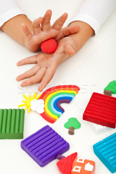 Child playing with colorful clay - closeup on hands Stock photo © ilona75