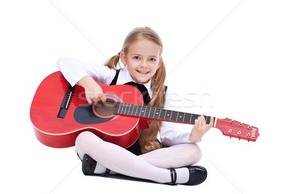 счастливым девочку гитаре сидят играет изолированный Сток-фото © ilona75