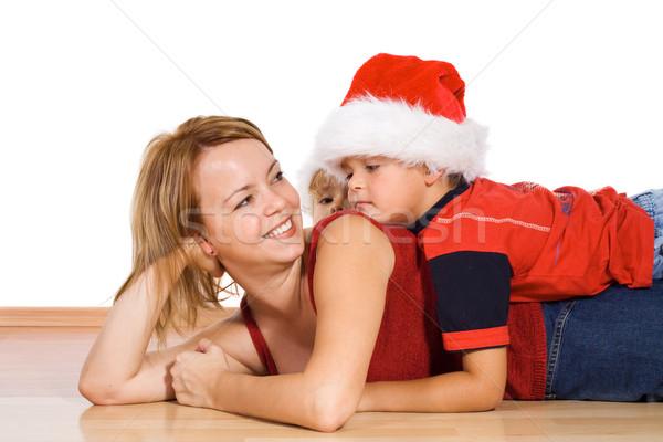 Woman and kids playing wearing santa hats Stock photo © ilona75