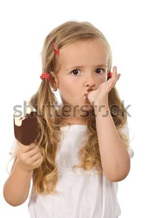 Petite fille manger crème glacée doigt visage heureux Photo stock © ilona75