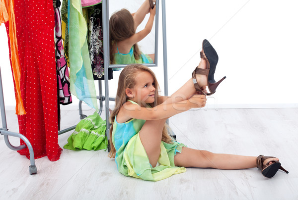 Little girl trying her mother's shoes and clothes Stock photo © ilona75