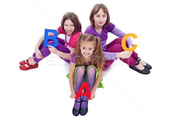 Young school girls holding letters of abc Stock photo © ilona75