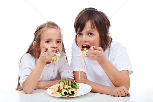 Gyerekek eszik tészta edény spagetti nagy Stock fotó © ilona75