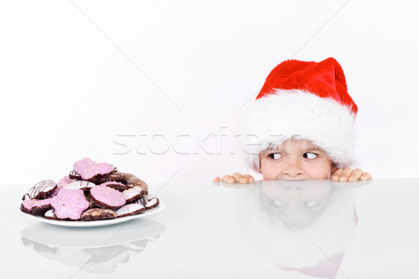 Boy peeking at the christmas gingerbread cookies Stock photo © ilona75