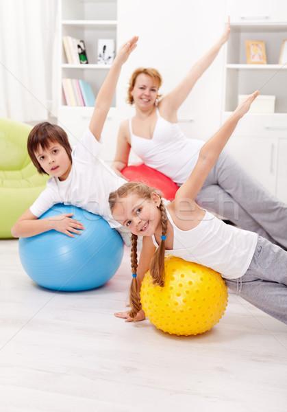 Egészséges élet testmozgás emberek nagy gimnasztikai golyók Stock fotó © ilona75