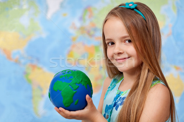 The world in my hands - little girl in geography class Stock photo © ilona75