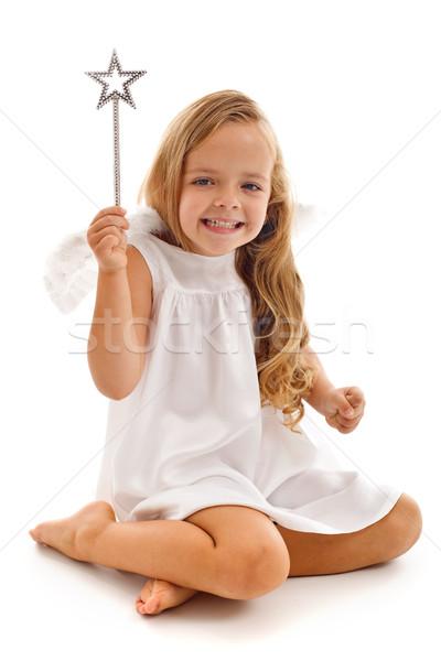 Happy fairy doing her magic Stock photo © ilona75