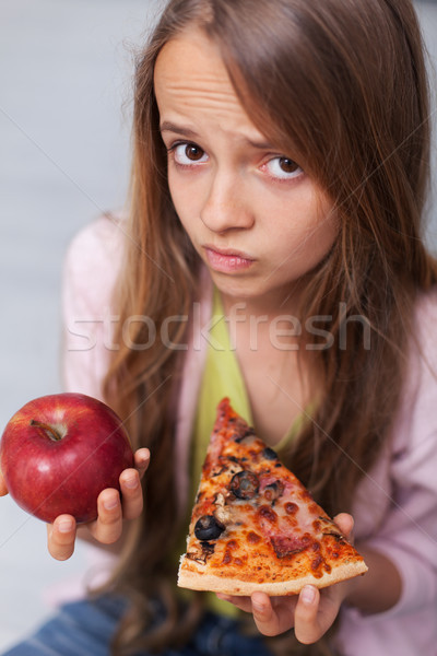 Young teenager girl cannot decide between appetizing pizza and h Stock photo © ilona75