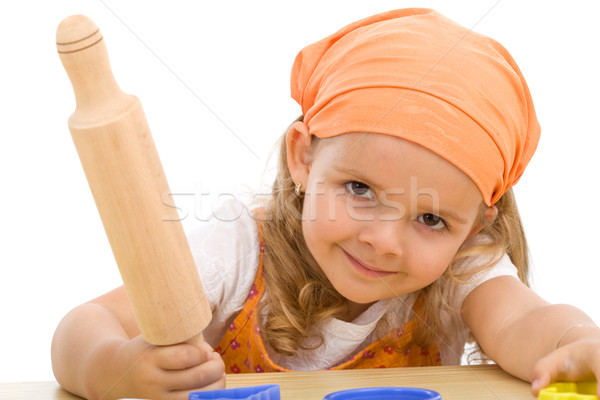 Happy girl with a rolling pin Stock photo © ilona75