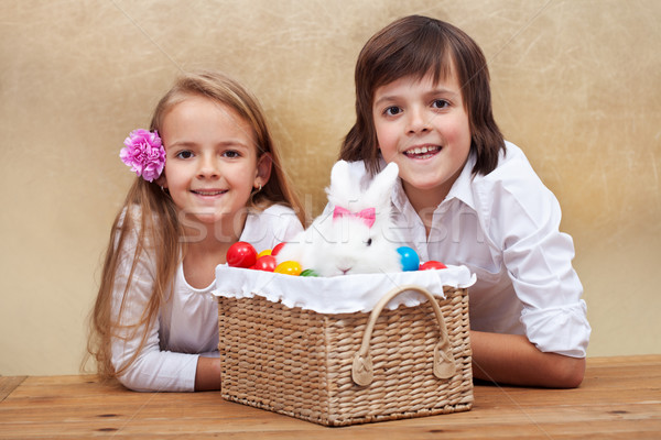 Happy kids with easter bunny and colorful eggs Stock photo © ilona75