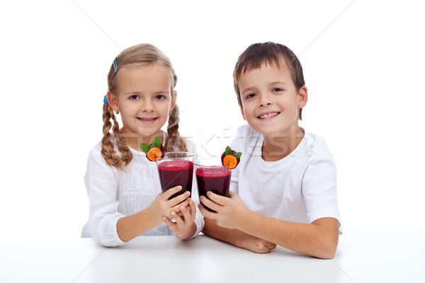Cheers - kids clink glasses of fresh beetroot juice Stock photo © ilona75