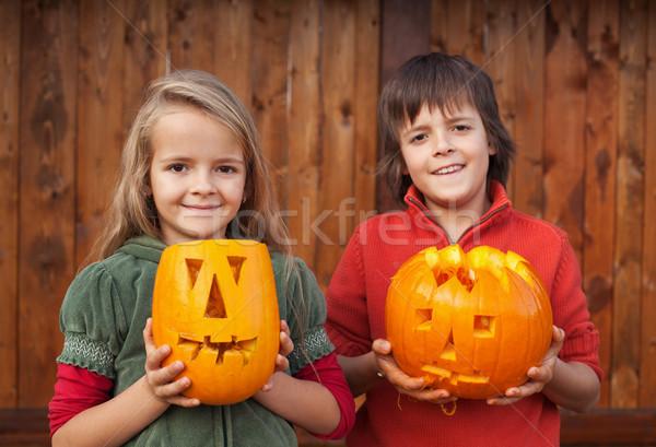 Kids with Halloween pumpkin jack-o-lanterns Stock photo © ilona75