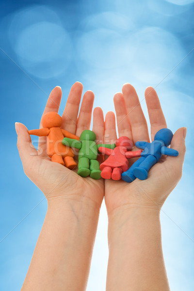 Colorful clay people in woman palm Stock photo © ilona75