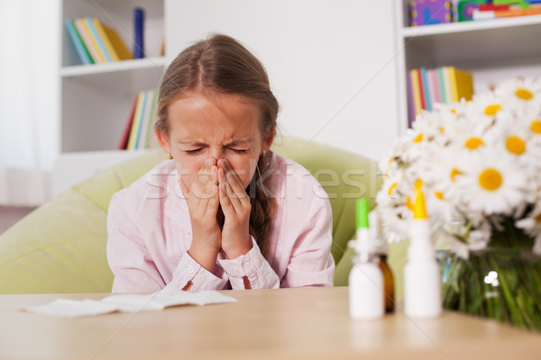 Young girl sneezing at home with paper towel prepared to blow he Stock photo © ilona75