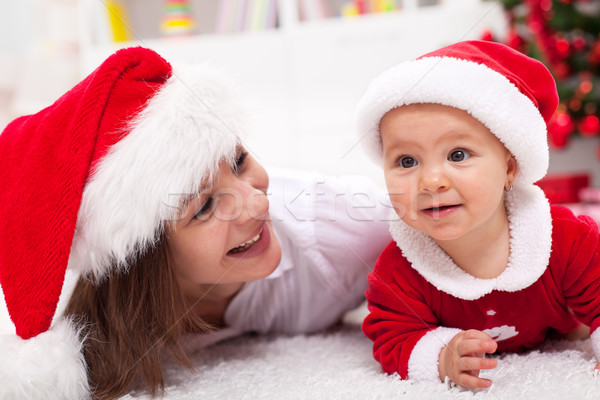 Our first Christmas - mother and baby with santa hats Stock photo © ilona75