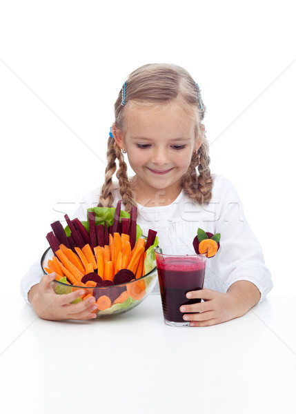 Little girl with fresh vegetables and juice Stock photo © ilona75