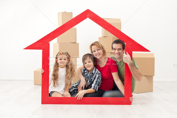 Happy family moving into a new home Stock photo © ilona75