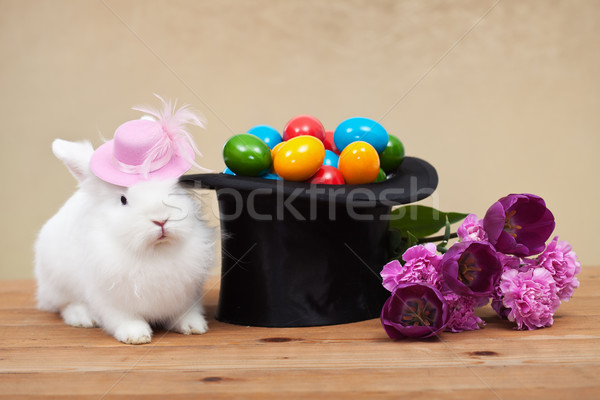 Cute easter bunny with spring flowers and colorful eggs Stock photo © ilona75