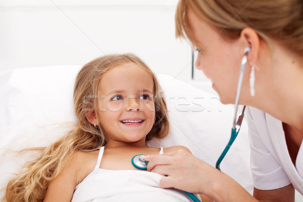 Little girl in bed having a health check Stock photo © ilona75