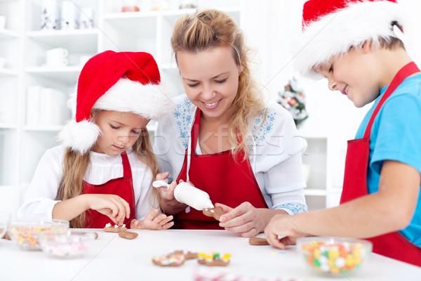 Family decorating christmas cookies Stock photo © ilona75