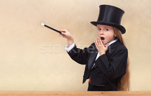 Surprised magician girl with magic wand Stock photo © ilona75