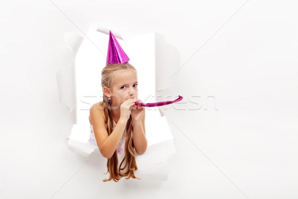 Little party girl with hat and whistle Stock photo © ilona75