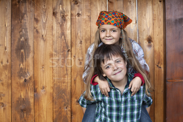 Happy kids portrait against wooden wall Stock photo © ilona75