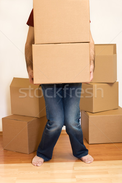 Man struggling with cardboard boxes - moving concept Stock photo © ilona75