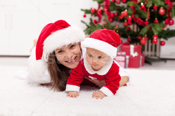 Our first christmas together - mother and baby girl in santa hat Stock photo © ilona75